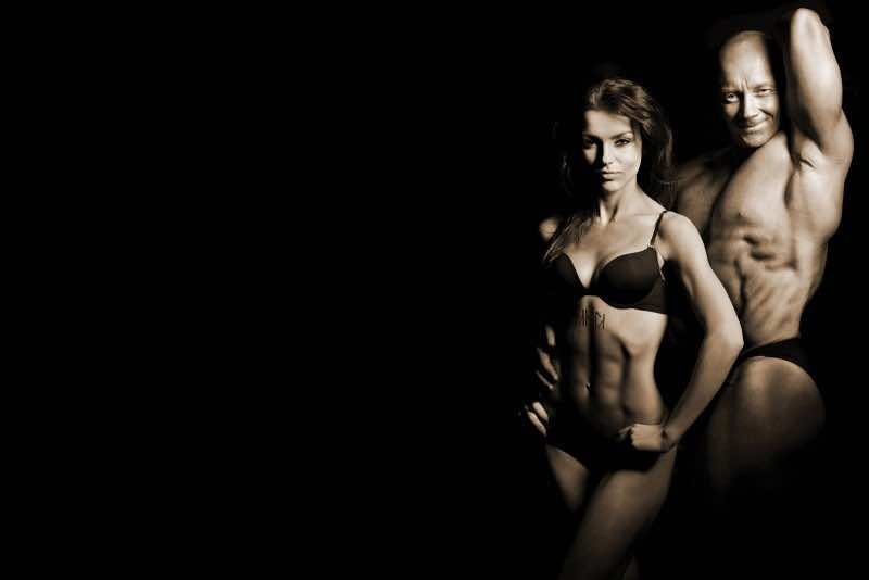 bigstock-man-and-a-woman-in-the-gym-26402681