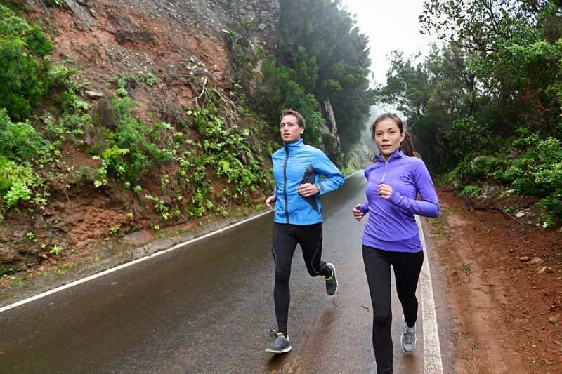 Healthy lifestyle people running on country road exercising. Run