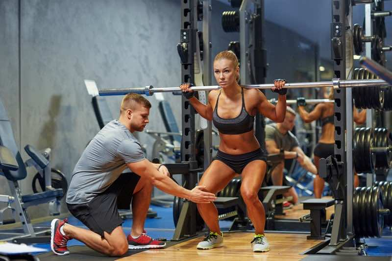 sport, fitness, teamwork, bodybuilding and people concept - youn