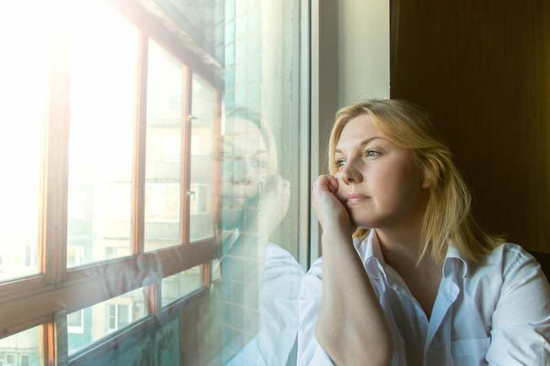 The Woman Lost In Thought Looking Out The Window.