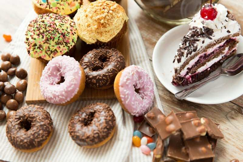 junk food, culinary, baking and eating concept - close up of gla