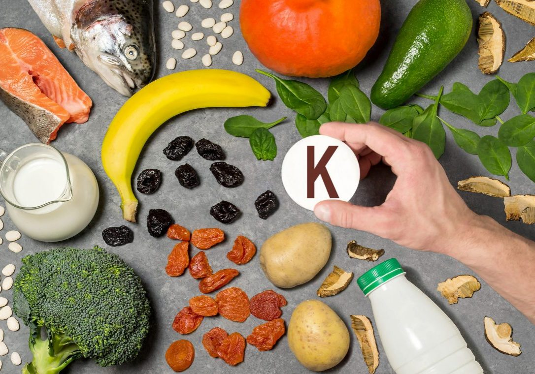 Food rich in potassium. Various natural sources of vitamins and micronutrients. Useful food for health and balanced diet. Prevention of avitaminosis. Man's hand holds tag with name of potassium