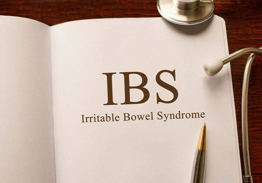 Page with IBS Irritable Bowel Syndrome on the table with stethoscope medical concept