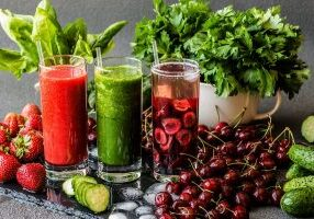 Strawberry smoothie. Detox water with cherries and green smoothie with ingredients. Healthy detox drinks