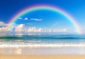 Beautiful sea with a rainbow in the sky. Karon beach Phuket Thailand, Asia