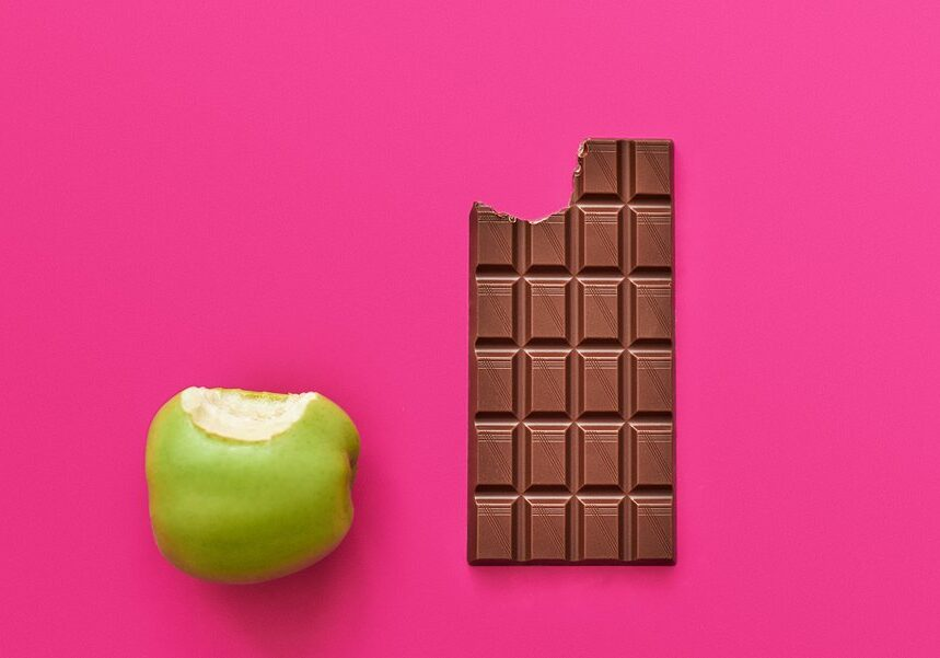 Dieting or good health concept.You have to choose between apple and chocolate