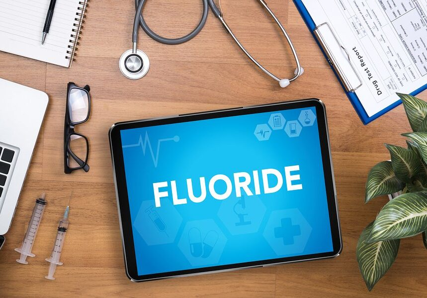 FLUORIDE Professional doctor use computer and medical equipment all around desktop top view