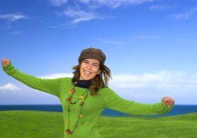 Happy woman in a great beautiful landscape