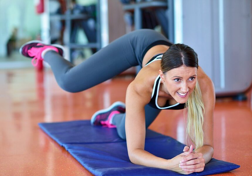 Sport woman streching. Fitness and yoga concept. Slim woman.