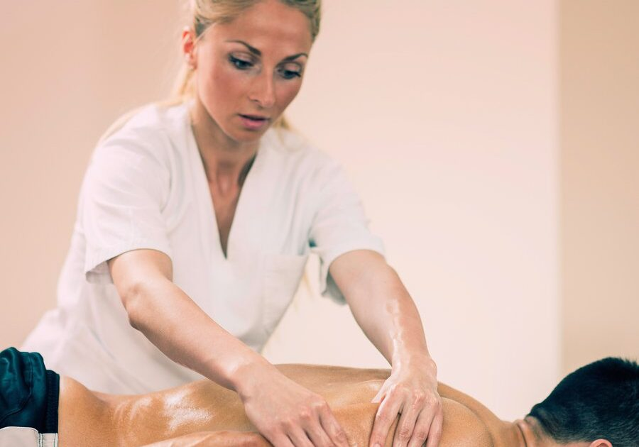 Sports massage - Arm massage - Physical therapist doing massage of arms. Toned image, focus set on hands.