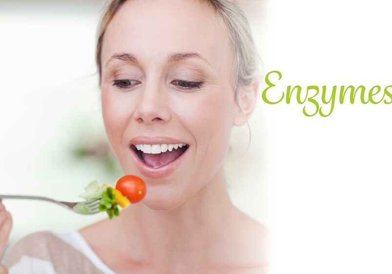 The word enzymes against woman eating a tomato