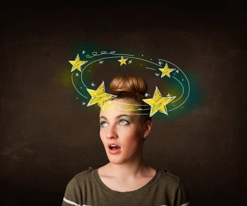 Young girl with yellow stars circleing around her head illustrat