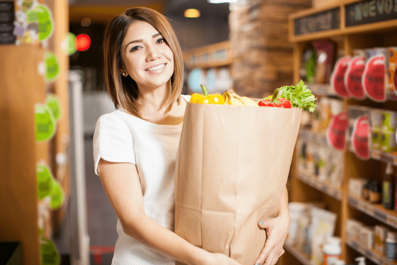 bigstock-Cute-Woman-With-A-Shopping-Bag-117945053