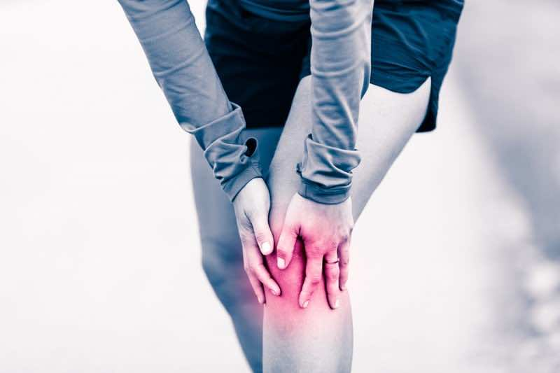Knee Pain, Woman Holding Sore And Painful Leg