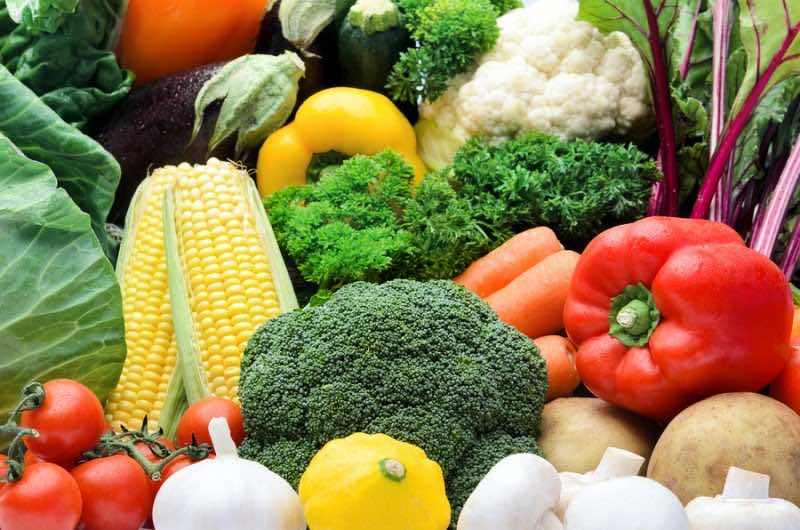 Close up of fresh raw organic vegetable produce, assortment of c