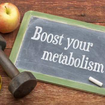 Boost your metabolism concept -  slate blackboard sign against w