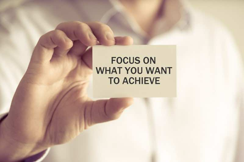 Businessman Holding Focus On What You Want To Achieve Message Ca