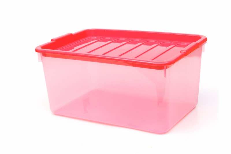 Transparent plastic storage box isolated on white