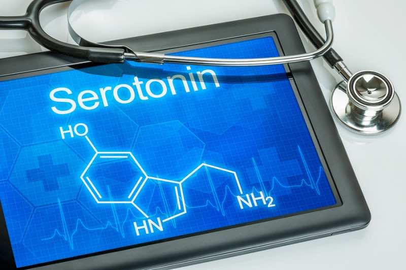 Tablet with the chemical formula of serotonin