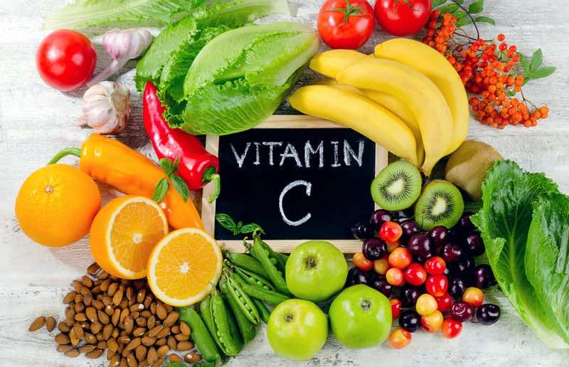 Foods High In Vitamin C On White Wooden Board.